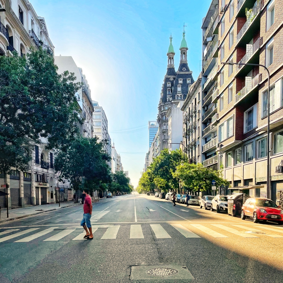 A man walks alone on a Buenos Aires road